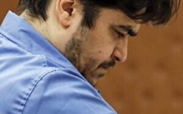 Ruhollah Zam pendant son procès devant le tribunal révolutionnaire de Téhéran en Iran, le 30 juin 2020. (Crédit : Ali Shirband/Mizan News Agency/AFP)