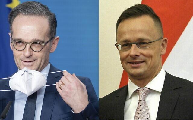 Le ministre hongrois des Affaires étrangères et du Commerce Peter Szijjarto, à droite, et Heiko Maas, ministre des Affaires étrangères allemand, à gauche. (Crédit : Attila Kovacs/MTI via AP / Kay Nietfeld/dpa via AP)