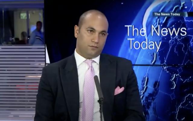 Patrick Aloni, soupçonné d'avoir escroqué 24 millions de dollars, lors d'un entretien avec i24News, le 14 mai 2014. (Capture d'écran :  i24News/Youtube)