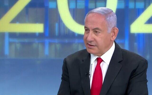 Le Premier ministre Benjamin Netanyahu s'exprime au journal télévisé de la Treizième chaîne, le 12 mars 2021. (Capture d'écran de la Treizième chaîne)