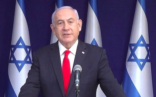 Le Premier ministre Benjamin Netanyahu affirme être victime d'une tentative de coup d'État politique, dans des remarques après les déclarations liminaires exposées à son encontre lors de son procès pour corruption, le 5 avril 2021. (GPO)