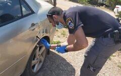 Les forces de police dans la ville de Kammaneh, dans le nord d'Israël, après un crime de haine présumé, le 9 avril 2021. (Crédit : Police israélienne)