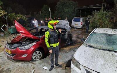 La scène d'une frappe à la roquette dans la ville de Lod qui a tué deux personnes, le 12 mai 2021. (Crédit : Magen David Adom)
