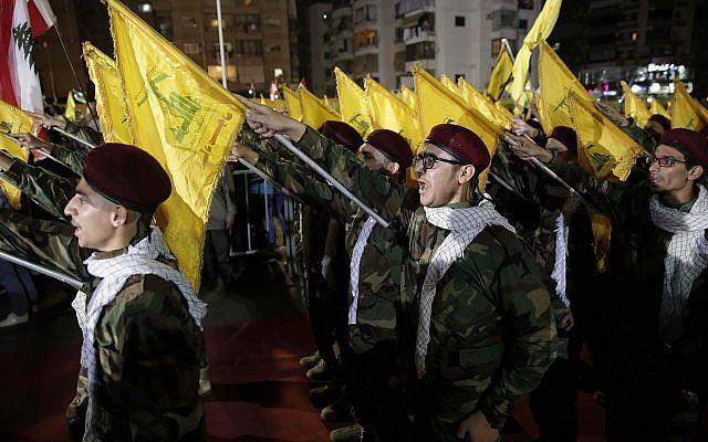 """La milice du chef du Hezbollah Sayyed Hassan Nasrallah prend part à un rassemblement pour marquer le """"jour de la fête de Jérusalem"""" ou """"Al-Quds"""" dans la banlieue de Beyrouth (Liban) le vendredi 31 mai 2019. (AP Photo / Hassan Ammar)"""