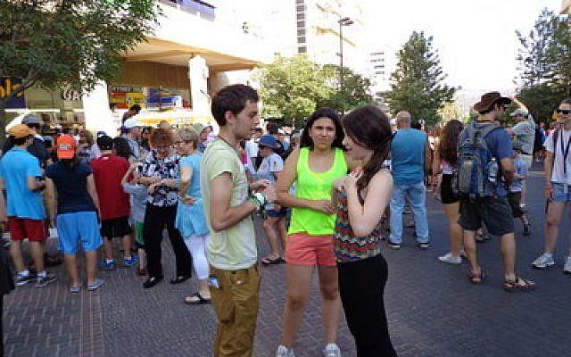 Mega Mission participants socialize on a Karmiel street (Abby Gordon photo)