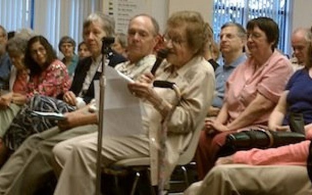 Former Pittsburgh Mayor Sophie Masloff, seated in the audience at Monday's roundtable on Pennsylvania's new voter ID law, reads from a prepared statement opposing the legislation. (Chronicle photo by Lee Chottiner)