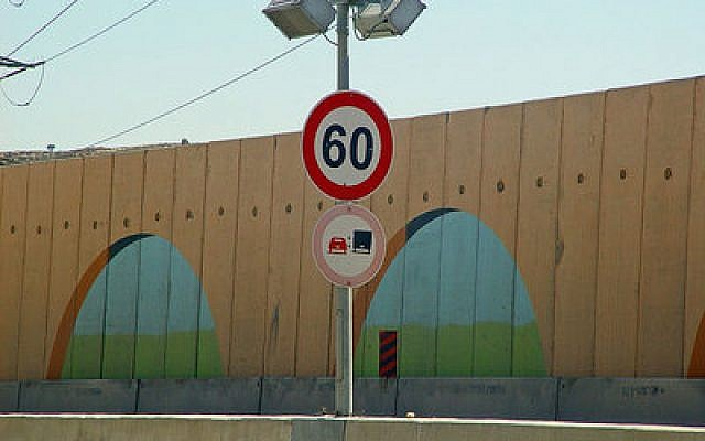 A section of Israeli-West Bank barrier located on Route 443 (Israel), near Jerusalem. Israelis say the barrier has saved many of lives since its erection, but proponents of the divestment resolution at last week's Presbyterian Church (USA) General Assembly only addressed hardships the Palestinians endure.  (Wikipedia photo)