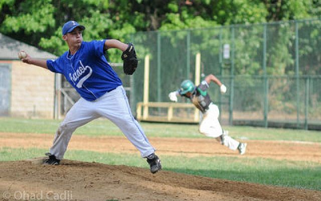 Yehuda Joffe, age 16, from Bet Shemesh, Israel, delivers pitch as an Allderdice baserunner breaks for second. (Chronicle photo by Ohad Cadji)