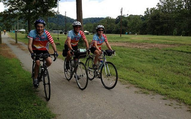 Adi Segal, center, completed the entire Hazon Cross-USA Ride, which started in Seattle and ends in Washington, D.C. Danielle Schindler, who rode from Chicago to Washington, D.C., joins him and his father, who joined the group in Pittsburgh. (Photo courtesy of Adi Segal)