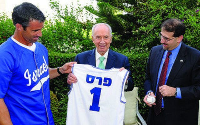 Israeli President Shimon Peres displays a Team Israel baseball jersey with his name on the back, which he received during a recent visit with Brad Ausmus (left) manager of Team Israel, and U.S. Ambassador to Israel Dan Shapiro. Team Israel will play in a qualifying round for the World Baseball Classic in September. (Photo by U.S. Embassy, Tel Aviv)