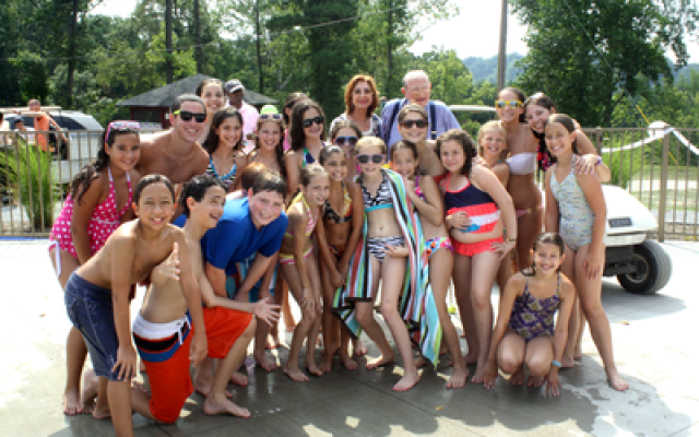 John and Leatrice Wolf with EKC campers on their recent visit to the West Virginia facility. (JCC photo)