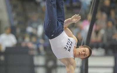Felix Aronovich performs a handstand as a Penn State gymnast during a recent collegiate competition. (PSU Athletics/Mark Selders)