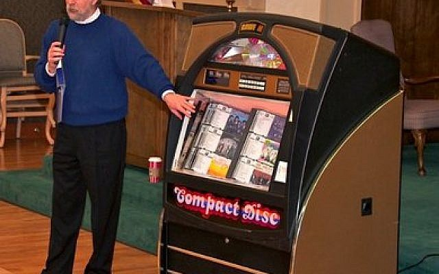 Dale Lazar, and one of his donated jukeboxes, during a Memories Remembered session. (Photo courtesy of Dale Lazar)