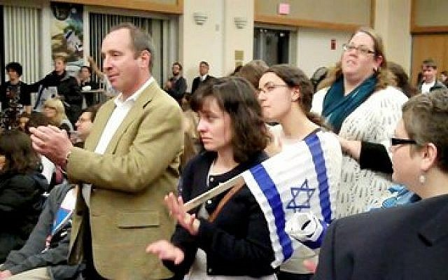 It was standing room only Monday at the Jewish Community Center in Squirrel Hill as hundreds of Jews from the city and suburbs turned out for the We Stand With Israel rally. (Chronicle photo by Lee Chottiner)