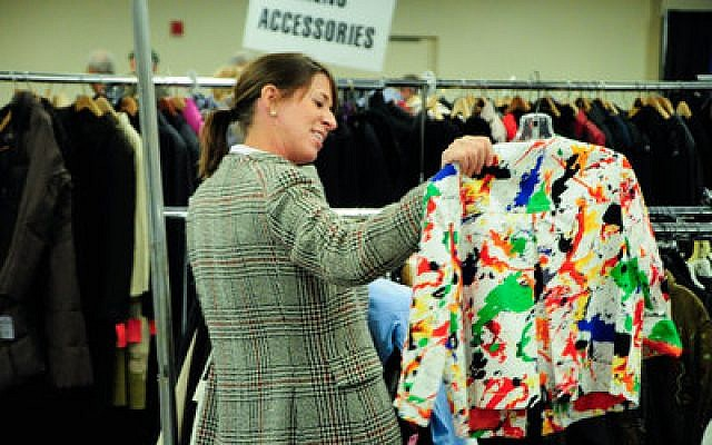 A shopper finds an interesting item off the rack at the Checkout Line event of the 2012 Designer Days last week at the Monroeville Convention Center. (Chronicle photos by Carl Bloss)