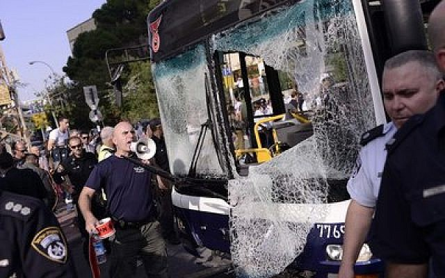 Prior to the cease-fire, Israeli police and rescue personnel at the scene of a bombing on a Tel Aviv passenger bus Wednesday, Nov. 21, that left 20 people wounded. (Credit: Tomer Neuberg/Flash90)