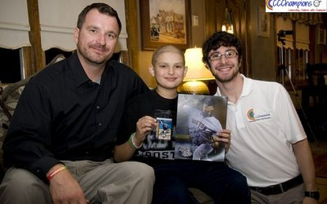 Former Boston Red Sox pitcher Brian Rose (left), with 11-year-old Jacob, a Red Sox fan, and Sidney Kushner. Front page: Jim Rooker, former pitcher for the 1979 World Champion Pittsburgh Pirates (left), with Kushner and 11-year-old Brett, an area cancer patient. (Sidney Kushner photo)