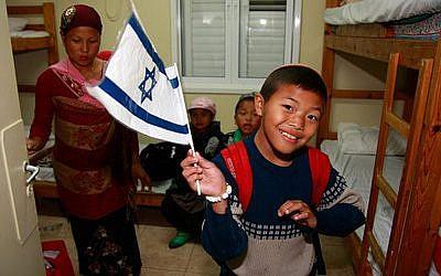 Bnei Menashe new arrivals at the absorption center on Dec. 24, 2012. (Ricki Rosen photo)
