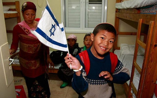 Bnei Menashe new arrivals at the absorption center on Dec. 24, 2012. (Ricki Rosen photo)