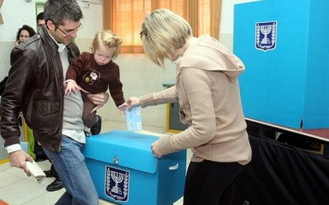 An Israeli family casts a ballot at a polling station in Tel Aviv on Feb. 10, 2009. (Flash90)