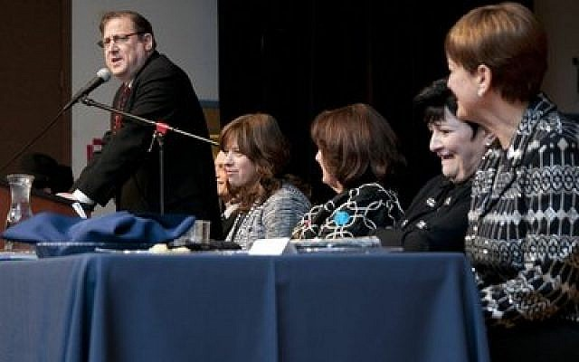 Dr. Dean Pollack, far left, and wife Chaya Pollack, far right (Chronicle photos by Lindsay Dill.)