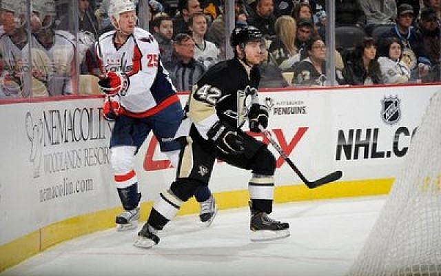 Dylan Reese, a Pittsburgh Penguins defenseman, plays behind the net during a recent game against the Washington Capitals at the Consol Energy Center. After a three-game call-up, the Penguins sent Reese, an Upper St. Clair native, back to Wilkes-Barre Scranton, its minor league affiliate, last week. (Photo courtesy of Pittsburgh Penguins)