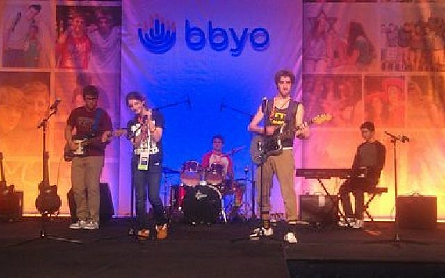 Daniel Keitel of Squirrel Hill, regional gadol for Keystone Mountain Region, sings lead in a rock band that performed at the just-concluded BBYO convention in Washington. The other band members, from around the country, are Ben Shepard, Scott Merritt, Brad Honigberg, Nora Stolzman and Alex Jerome. (KMR photo)