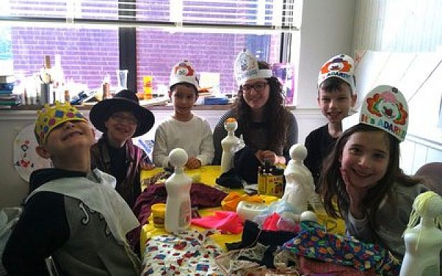 Children at Chabad of the South Hills Hebrew School of the Arts welcomed the month of Adar with extra joy. They are creating original puppets of characters in the Purim story. (Chabad of the South Hills photo)