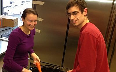 Students Shuli Carroll and Russell Sparks prepped vegetables Monday in the Hillel JUC kitchen. (Hillel JUC photo)