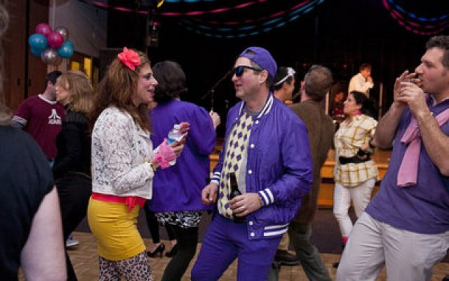 Gala attendees Jennifer and Larry Honig dancing to the '80s cover band, The VIPs. (Chronicle photos by Ohad Cadji)