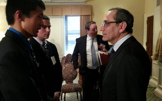 Shady Side Academy seniors Perry Cao and Tony Satryan speak with Egyptian Ambassador to the United States Mohamed M. Tawfik Friday during a luncheon at the Duquesne Club, Downtown. (Chronicle photo by Matt Wein)