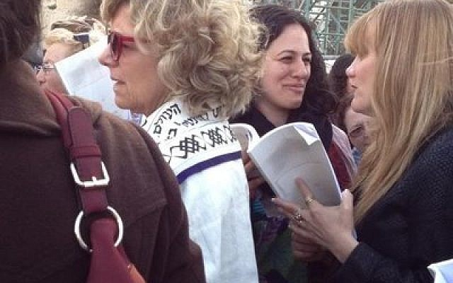 Lynn Magid Lazar (draped in a white tallit) joined members of Women of the Wall, together with other visitors and some Members of the Knesset, to pray unmolested at the Western Wall last week during Rosh Chodesh. Women praying at the Western Wall with prayer shawls and the Torah has been a source of friction between liberal and haredi Jews. (Photo courtesy of Lynn Magid Lazar)