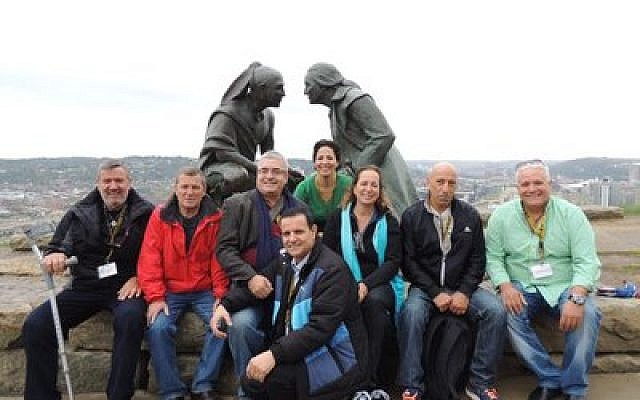 "This year's delegation of disabled Israeli war veterans are pictured here at the ""Point of View"" statue on Crafton Heights. The sculpture depicts George Washington and the Seneca leader Guyasuta in a face-to-face meeting in October 1770. The veterans were hosted by Jewish Pittsburgh families during their stay here and also visited Buffalo and Lancaster."