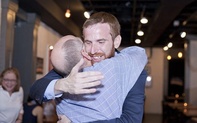 Dan Gilman embraces his friend Malika Sinha during his election party at Up Modern Kitchen in Shadyside, Tuesday, May 21. Gilman won the Democratic primary for City Council in Pittsburgh's 8th District that day. If he wins in November, he will be the first Jewish Pittsburgh councilman since Dan Cohen. (Chronicle photo by Ohad Cadji)