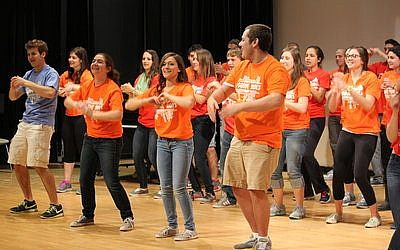 J-Serve began Sunday with a flash mob dance to get teens motivated for a day of volunteering. Below, bad weather didn't stop 250 Jewish teens from boarding buses outside the Jewish Community Center in Squirrel Hill and traveling to 17 different sites throughout Pittsburgh as a part of J-Serve. (J-Serve photo)