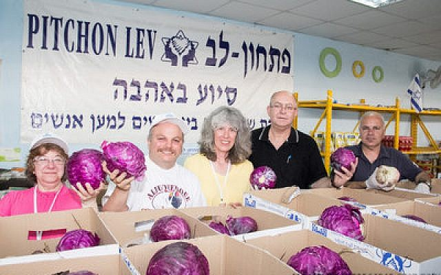 Pittsburgh volunteers Reesa Rosenthal, Jon Halpern, and Ellen Leger joined with staff members from Pitchon Lev to prepare food baskets for disadvantaged Israeli families on the just-concluded volunteers mission. (Jewish Federation photo by Alex Huber)