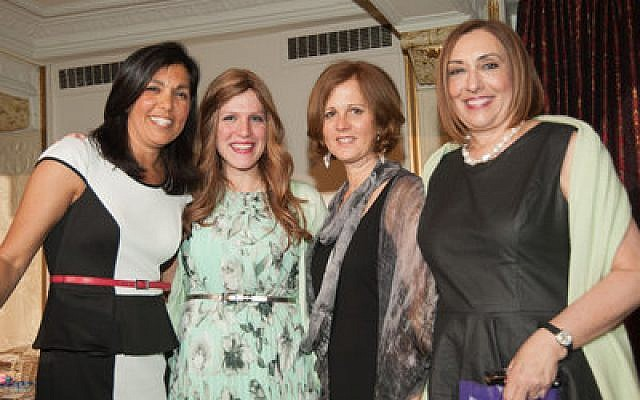 From left, Amy Spear, the emcee for the program, poses with Rivkee Rudolph, director of Friendship Circle, and Amy Weiss and Ina Gumberg, co-chairs of the event.