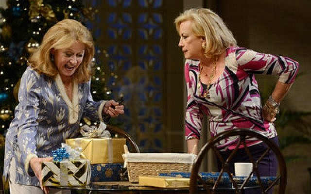 "Helena Ruoti (l) as Polly, and Susan Cella as Silda, wrap Christmas gifts in ""Other Desert Cities."""