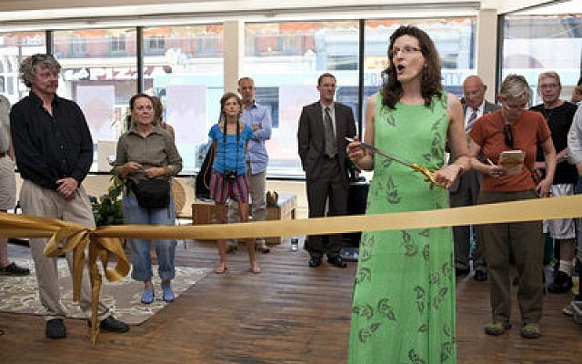 Elisa Beck gives a speech before cutting the opening ribbon Friday, June 21, during the opening ceremony of the new Schwartz Market on the South Side. (Chronicle photo by Ohad Cadji)