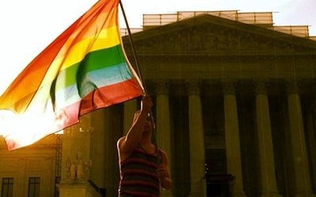 A same-sex marriage advocate is pictured outside the Supreme Court Wednesday, June 26. (Tablet Magazine photo)