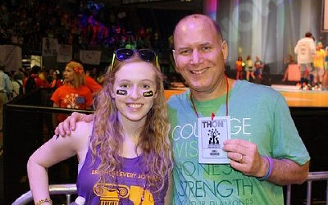 Once the reason for a fundraising effort across Pittsburgh, Amy Katz, now a senior at Penn State, today raises money for worthy causes. Katz is pictured at the Penn States fundraiser, THON, with her father, Mike Katz, who was at the event. (Katz family photo)