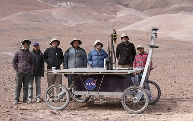 Carnegie Mellon University researcher David Kohanbash, pictured fourth from left, is part of the NASA operation being led by CMU and the SETI Institute in the Atacama Desert in Chile. Pictured with the team is Zoe, the NASA robot.