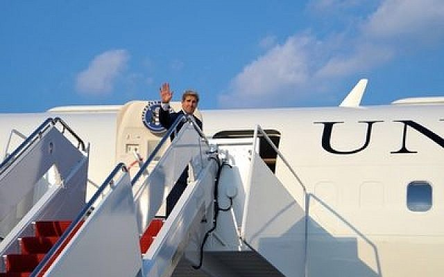 U.S. Secretary of State John Kerry waves as he boards his plane at Andrews Air Force Base for a flight to Amman, Jordan, July 15. (U.S. Department of State photo)