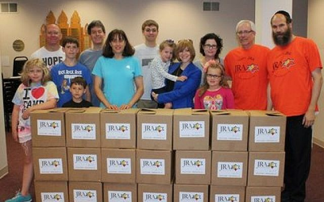 Volunteers for the Pittsburgh Jewish Relief Agency in Fox Chapel pack and deliver boxes of food to waiting families. (Pittsburgh Jewish Relief Agency photo)