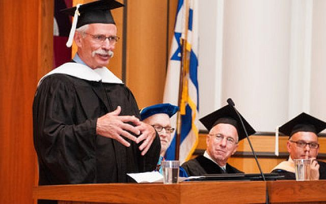 Doctor of Humane Letters awardee David Shapira shares his experiences Monday, Oct. 7, during the commencement ceremony for the Jewish Professional Studies program. (Chronicle photos by Lindsay Dill)
