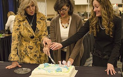 NCJW members cut the cake in celebration of their 120th birthday during the 43rd annual NCJW Designer Days sale. (Photos courtesy of NCJW)