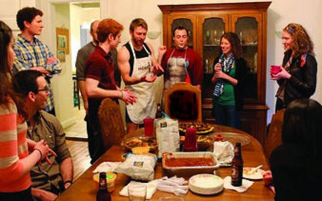 """Members of Moishe House Pittsburgh recently held a food-centered event similar to the one pictured above. The event, paid for by a """"micro-grant"""" from the Jewish Agency for Israel, was an Iron chef-style contest for hummus lovers. (Photo by Naomi Fireman)"""