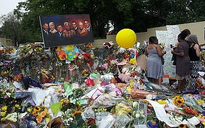 Many South Africans left flowers, paintings and other tributes outside the home of Nelson Mandela. The famous anti-apartheid activist and first democratically elected president of South Africa died Thursday, Dec. 5. He was 95. (Photo courtesy of Marlene Behrmann)