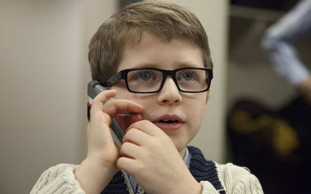 Noah Indianer, 8, talks to a donor on the phone. (Chronicle photos by Sam Oshlag)