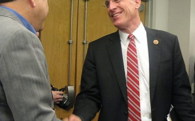 U.S. Rep. Tim Murphy (R-Upper St. Clair) shakes hands with Eric Perelman, a member of the Jewish Family & Children's Service board of directors, during his visit to JF&CS last week. Murphy stopped by to discuss the Helping Families in Mental Health Crisis Act, which he is sponsoring. (Elizabeth Waickman photo, JF&CS)